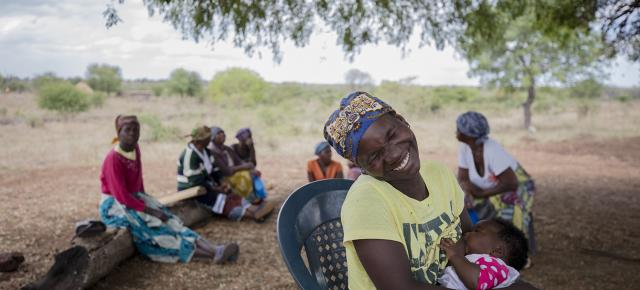 Rostalina Mucavele, age 26, holds her baby, during a family planning discussion in Mahungo Village, Mozambique