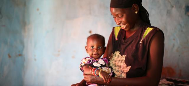 A portrait of Ndeye Ngom and her daughter Shady Kaye in her home in Ndienne, Senegal
