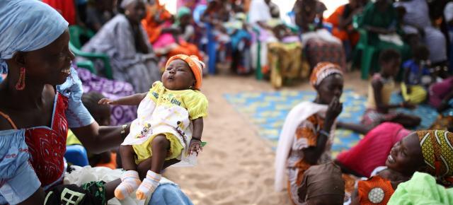 Members of Balol Elimane village, Senegal talk with their neighbors