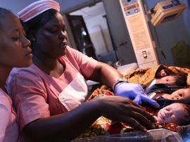 Registered nurses look after newborns at a maternity hospital in Freetown Sierra Leone.